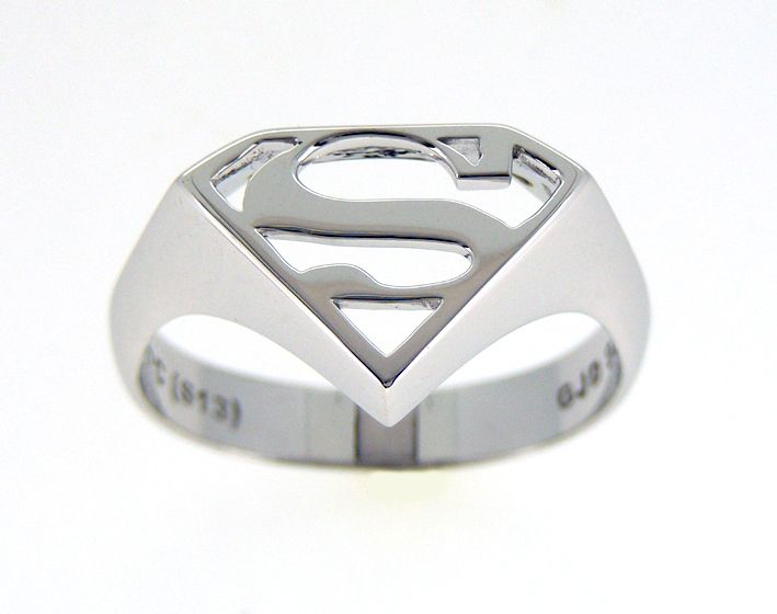 "Superman Signet Ring: Superman, the last son of Krypton; raised on Earth and fights in the pursuit of truth and justice. This hand finished Sterling Silver Ring displaying the Superman shield and the family insignia of the ""House of El"" is of the highest quality meeting the world standard for jewellery. This ring is of a high polish finish and comes Rhodium Plated to resist tarnish and improve lustre.  Comes available in 3 Sizes: AU Sizes: Q, U and Z. US Sizes: 8, 10 and 13."