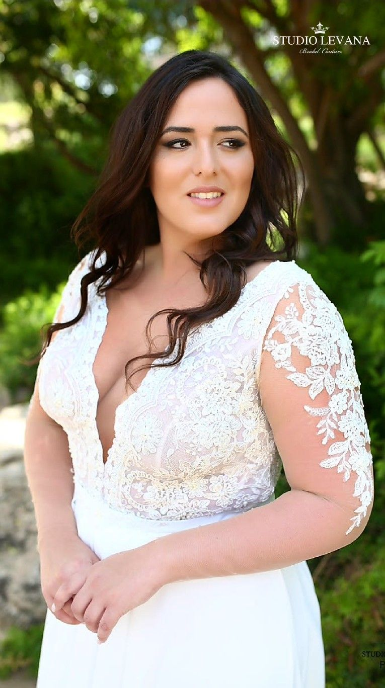 Sexy plus size wedding gown with illusion sleeves and deep cleavage