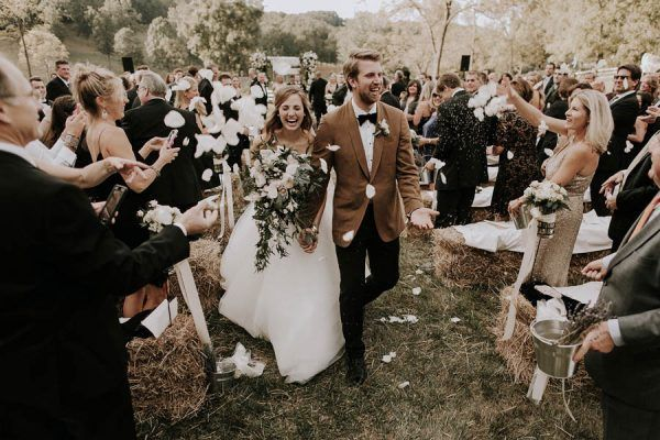 Nothing cuter than this happy wedding recessional | photo by Bradford Martens
