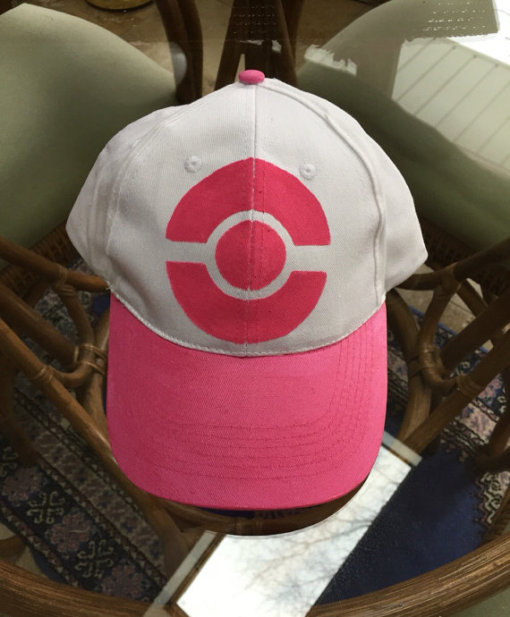 66f4973d319 Painted brim and trainer symbol. This pink hat is worn by the girl ...