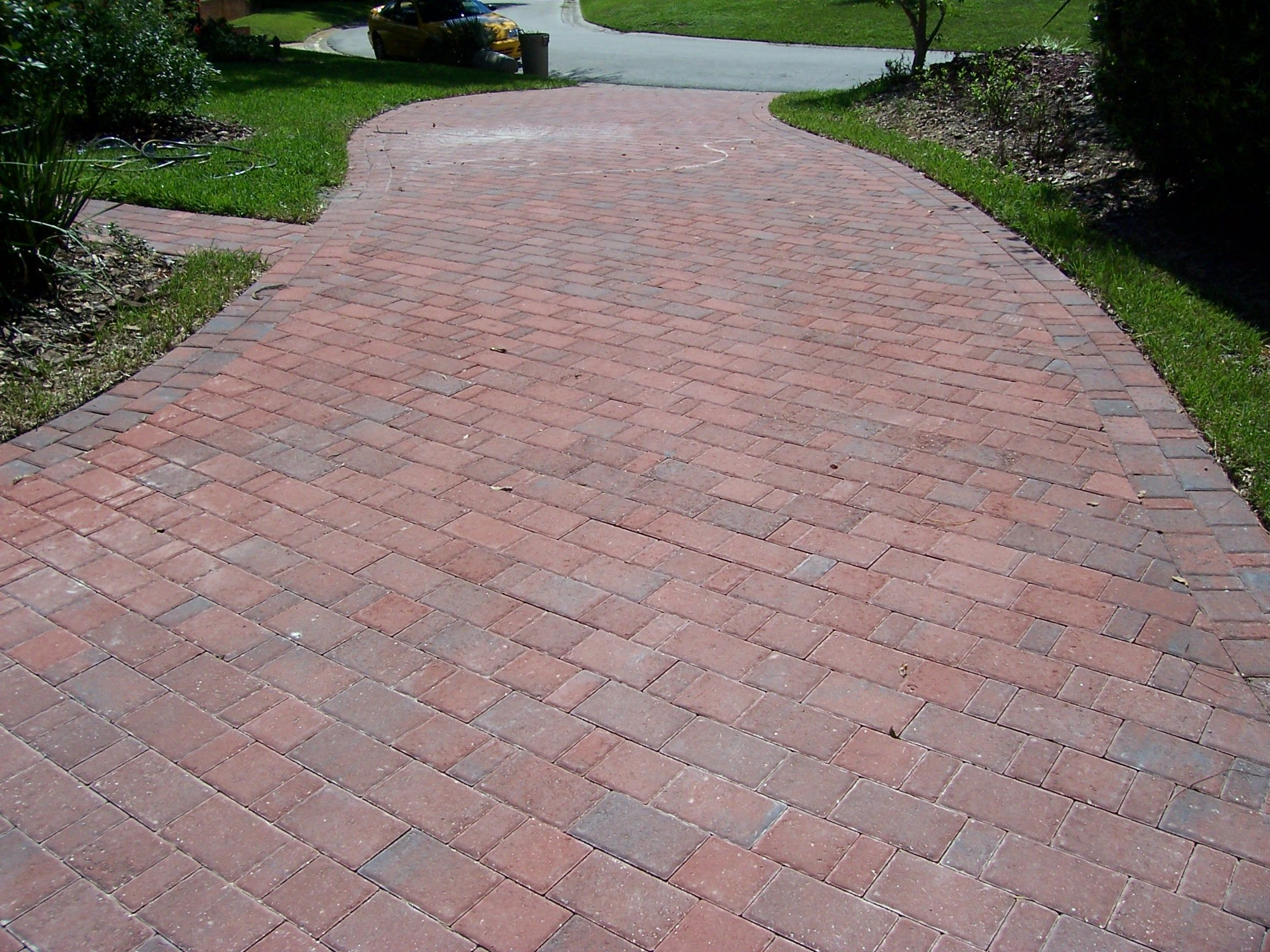 Paver patio on a slope google search landscaping for Sloped driveway options