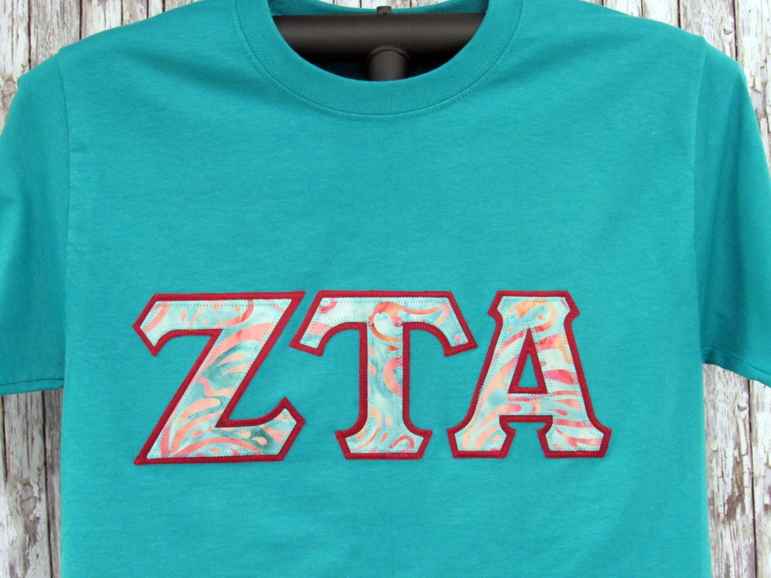jade short sleeve shirt with batik print sorority double stitched letters shirt by mainstreetsorority on etsy