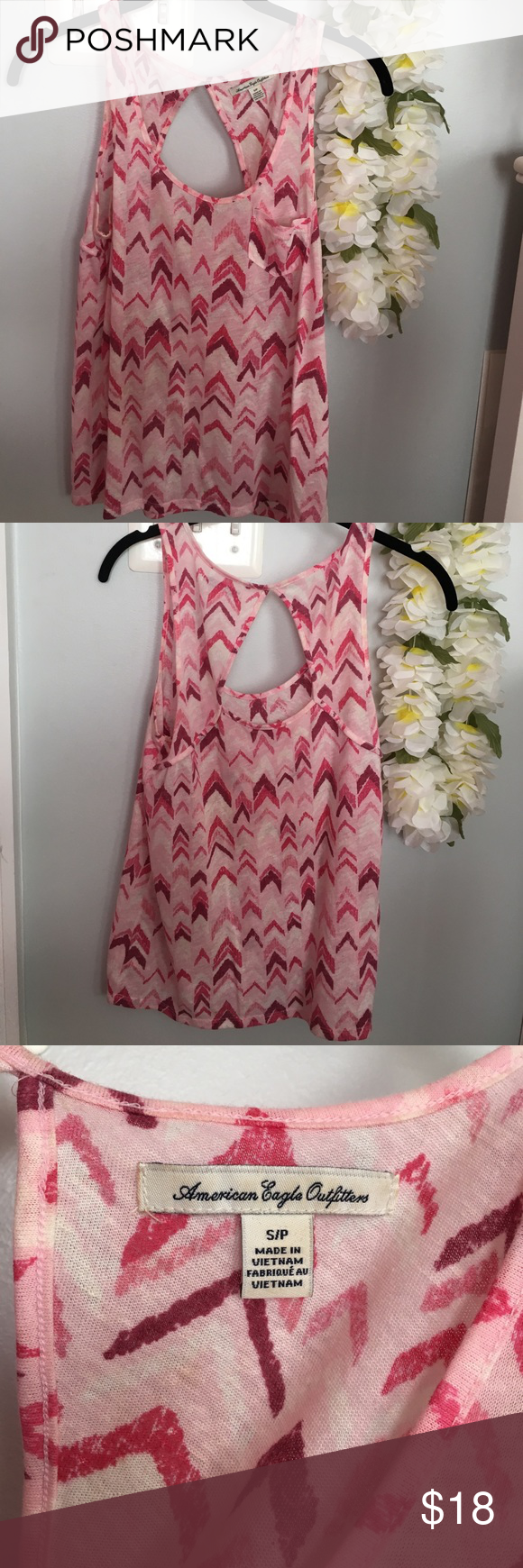 Pink and burgundy patterned front pocket tank top Used a few times but still in great condition! Great for the summer! American Eagle Outfitters Tops Tank Tops