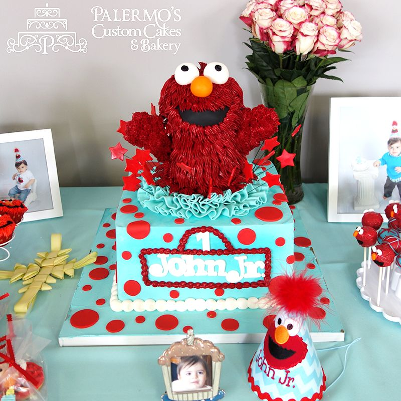 All edible Elmo confections accompanied this 3D Elmo cake created