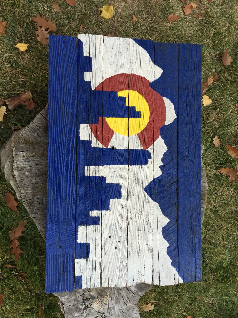 Stated as old fence that was falling apart. Now it's a hand painted Colorado skyline flag.   Flags are for sale on etsy and over the phone just call 720-422-2410
