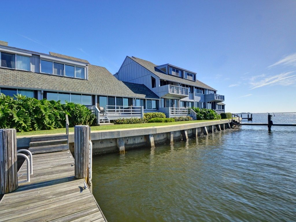 Magnificent river views from this 3br/3ba riverfront condo in a prime location at the Moorings. Imaginatively updated in a fresh, crisp color palette reflecting its waterfront setting. Neutral tile, open kitchen, large balcony/porch, private dock, community clubhouse and pool, onsite manager, and granted beach access. One pet up to 35 lb. Sizes are approx./subj. to error.