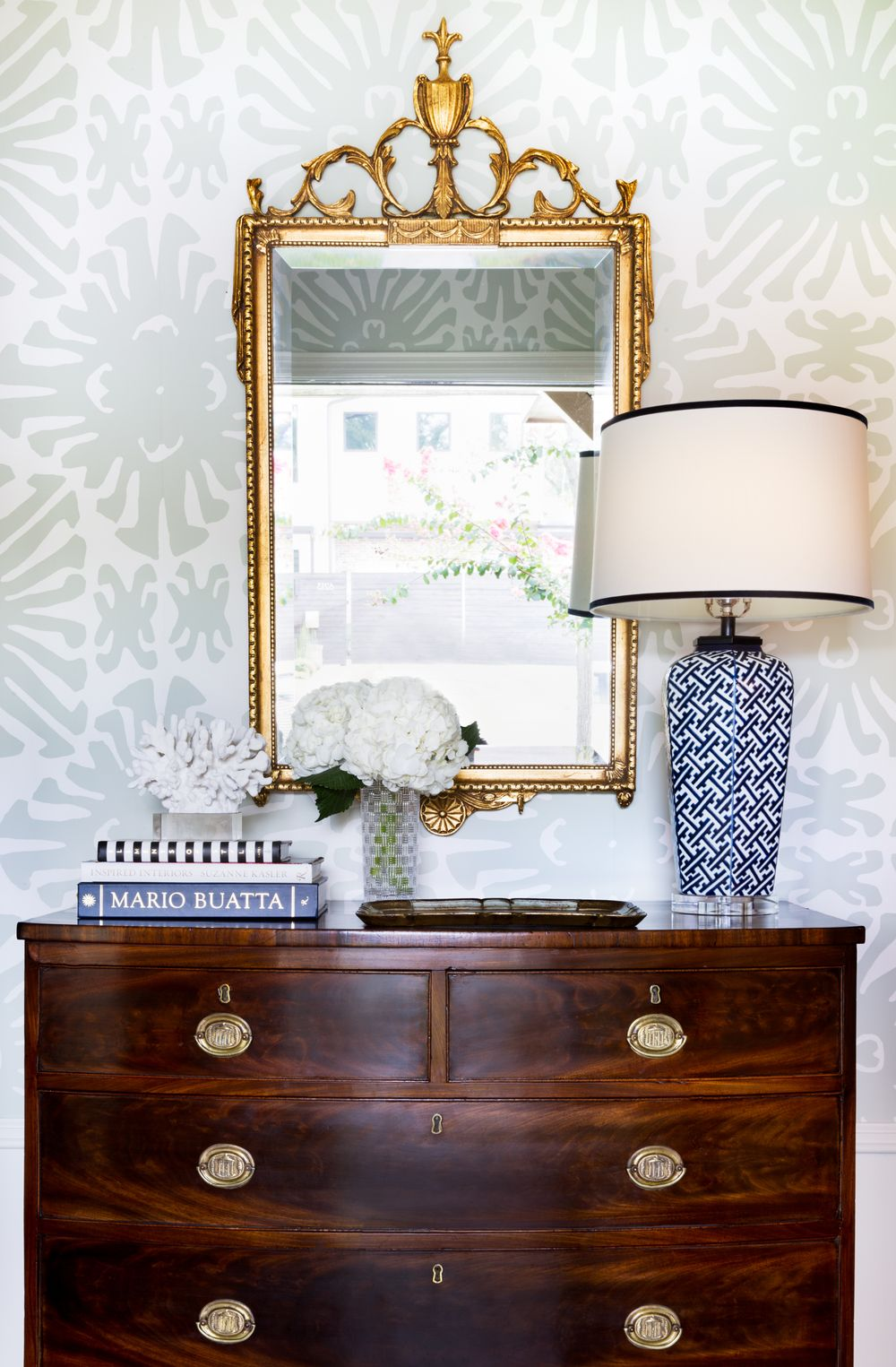 walls + lamp + warm antique wood bureau + gilded mirror + brass accents + white flowers (Jennifer Barron Interiors)