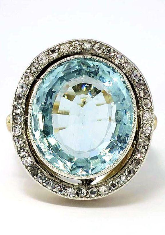 Shimmering 1940s Aquamarine & Diamond Halo Art Deco Ring