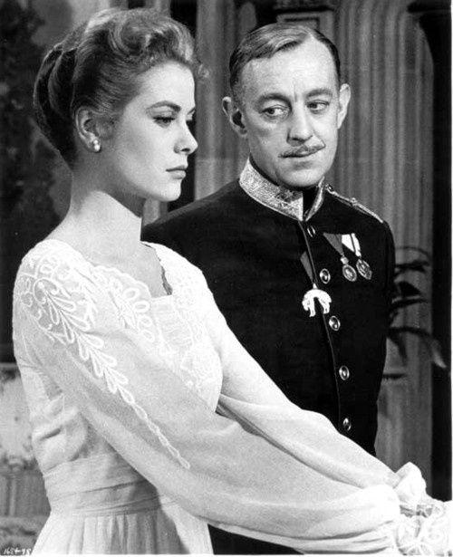 Grace Kelly con Alec Guinness
