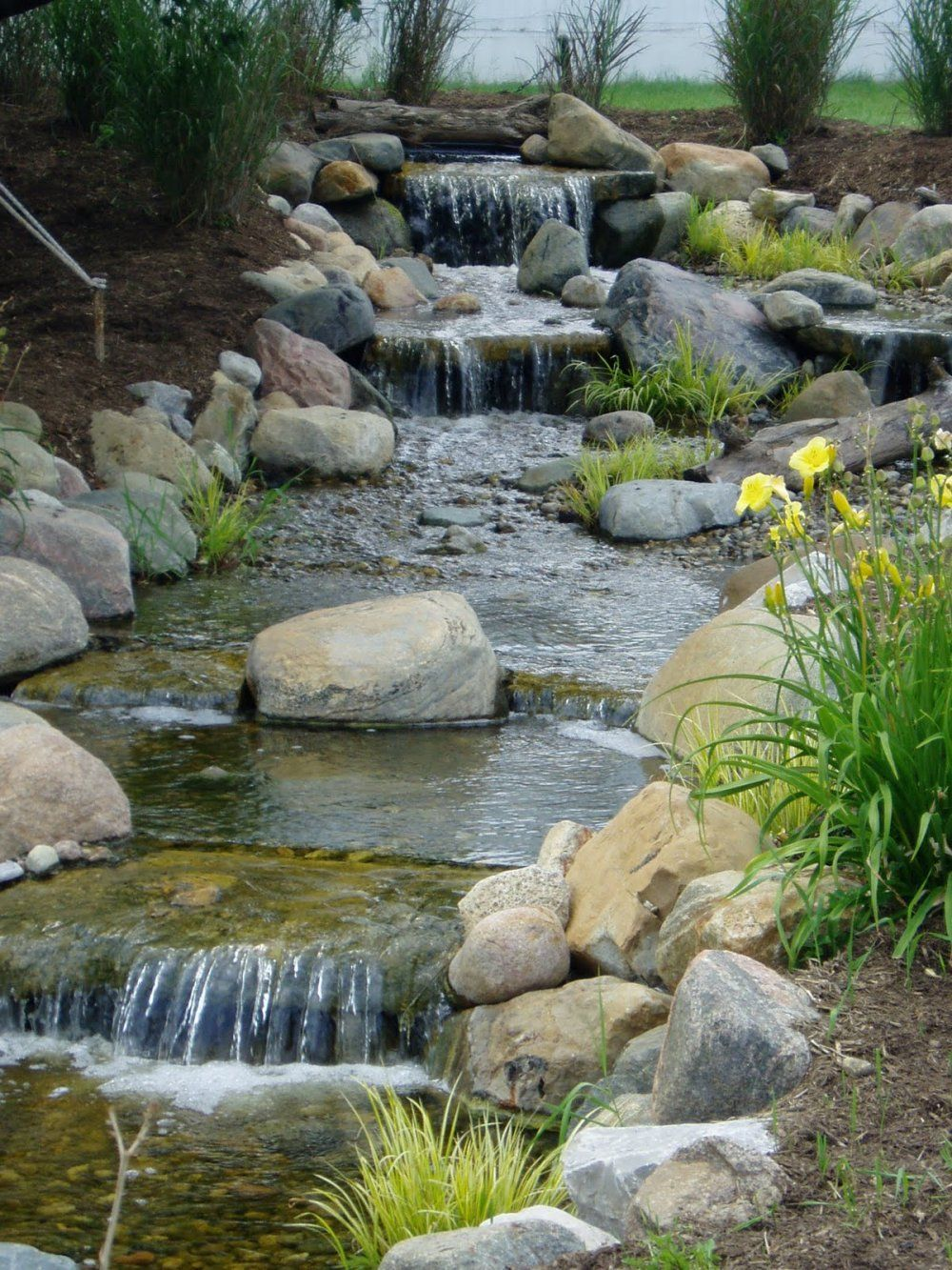 Here 39 s a lovely pond waterfall with four levels ponds Backyard pond ideas with waterfall