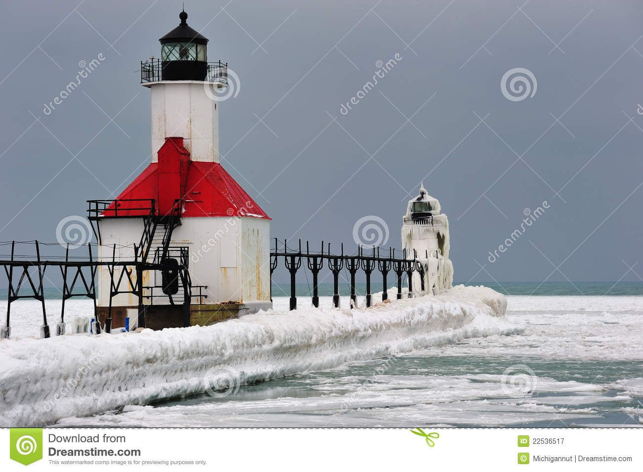 Joseph Lighthouse coated in a thick layer of ice in this Michigan Winter scene. Description from dreamstime.com. I searched for this on bing.com/images