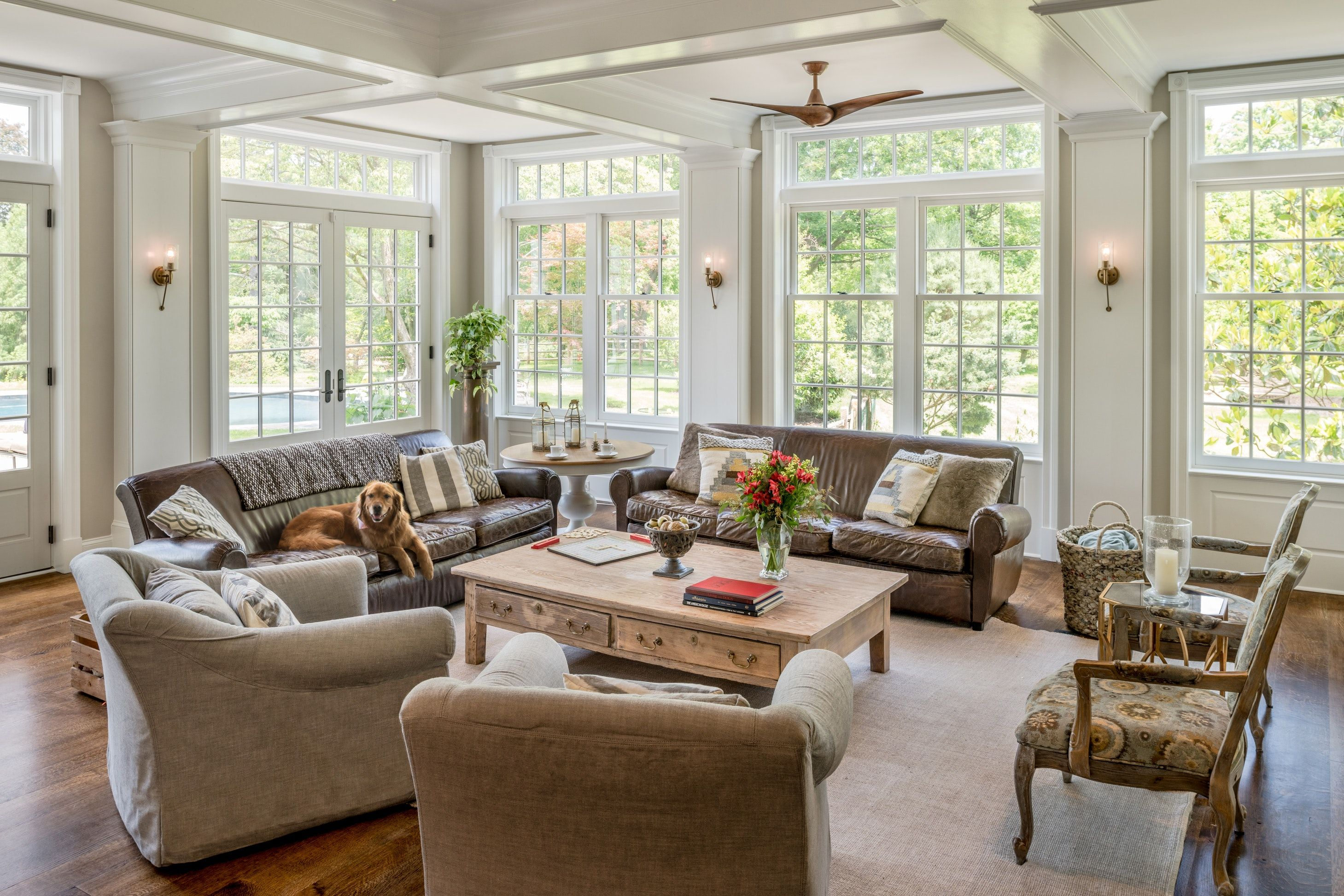 Bright White Traditional Family Room Addition With Lots Of Windows And View Family Room Addition Room Additions Family Living Rooms Living rooms with lots of windows