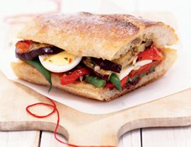 Pan bagnat is a French sandwich made by filling a loaf of country bread with layers of veggies, olives and eggs. The sandwich is then allowed to sit several