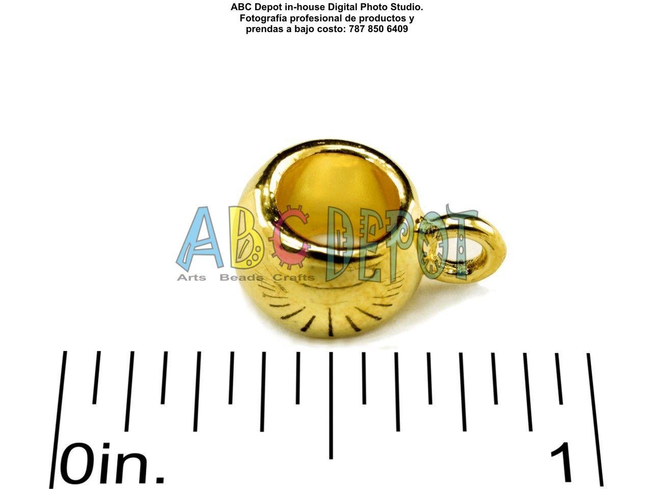Rondelle en metal libre de plomo y cadmio de 13.5x10mm para hilo o cuero de hasta 5mm y argolla. Color oro.  Código: LRP135