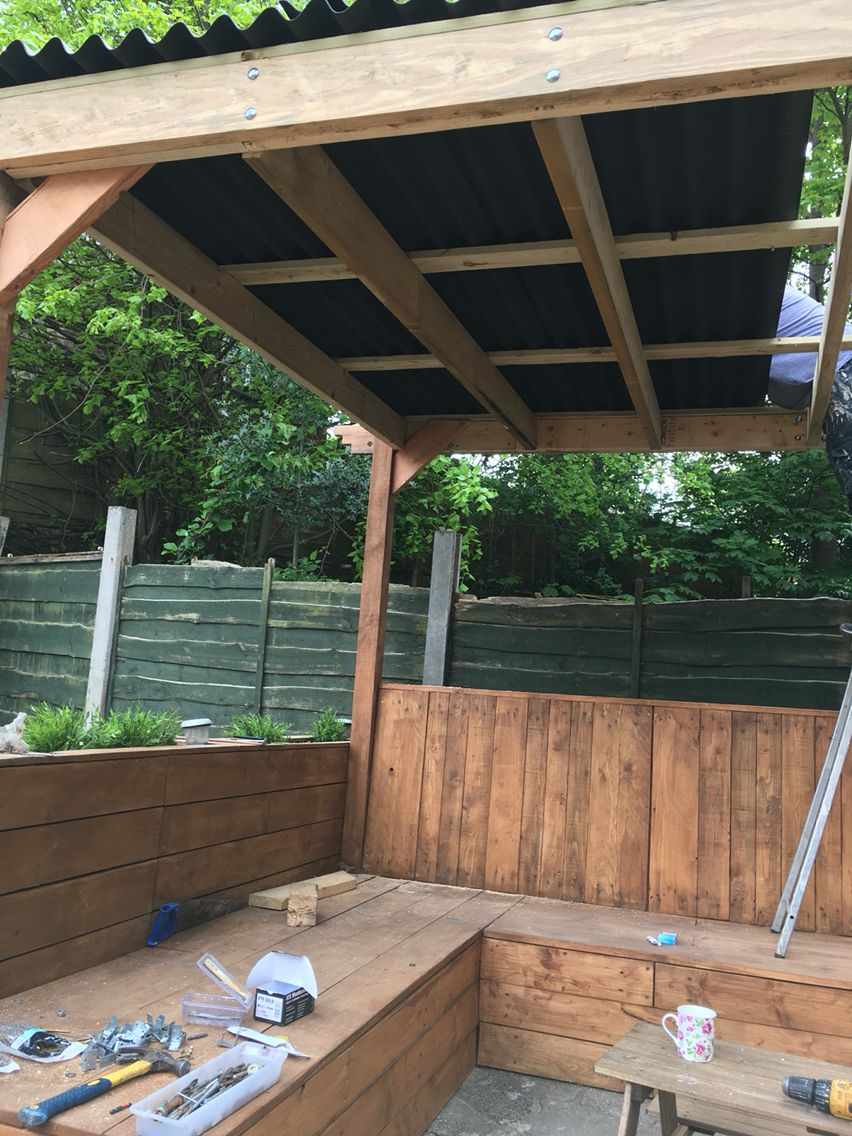 Roof Is Going On The Pergola Chose Bitumen Corrugated Roofing So It S Not Too Loud When It Rains Pergola Rustic Pergola Corrugated Roofing