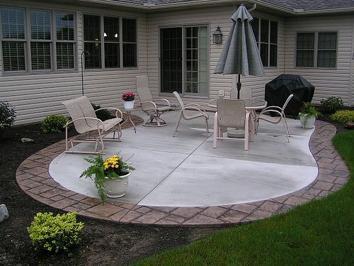 stamped concrete patio with border by swiss village concrete