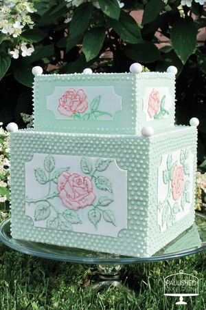 This cake is reminiscent of a summer garden! Another one of Paulished Confections cake creations