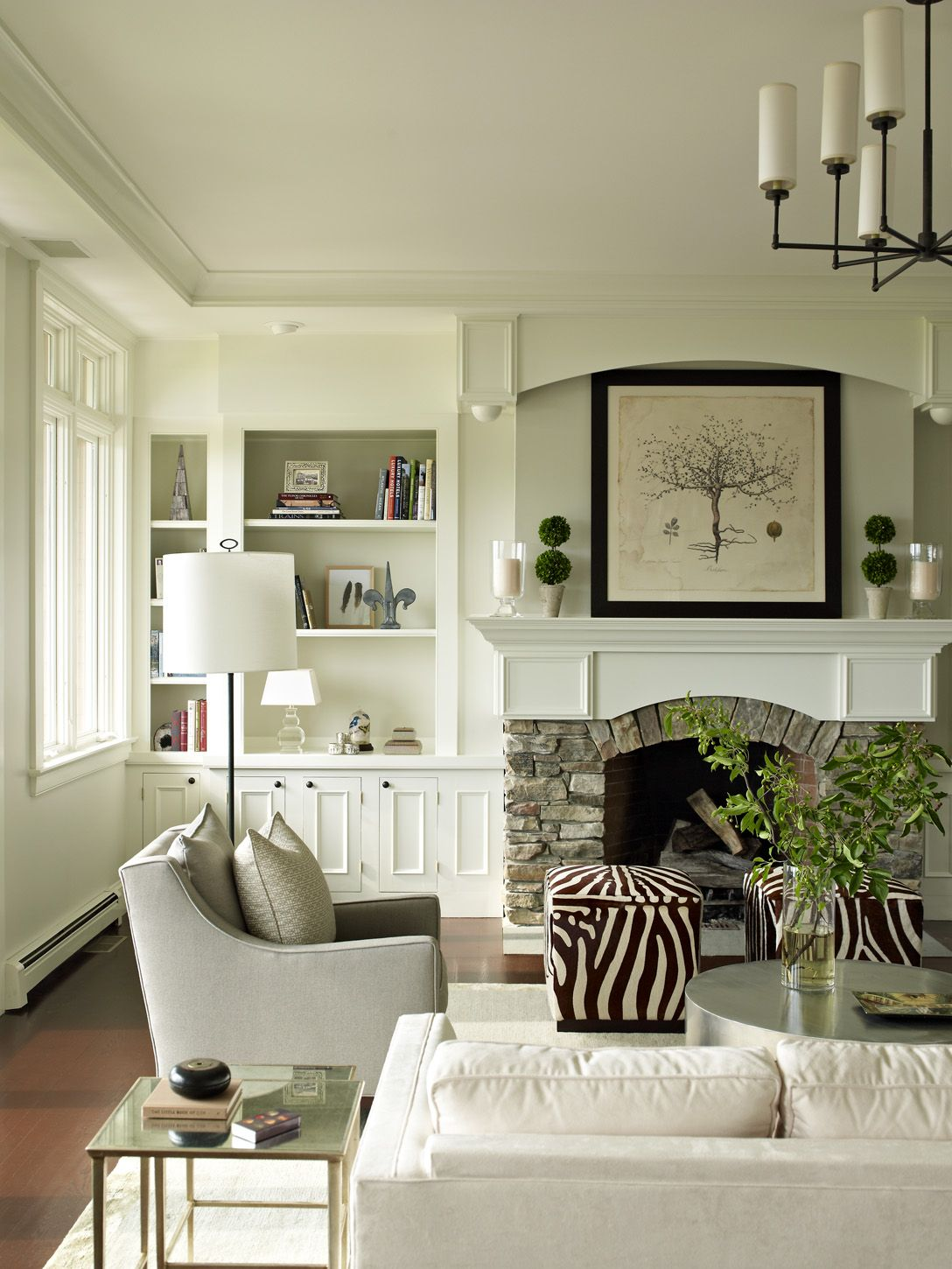 white built in bookcases, stone fireplace