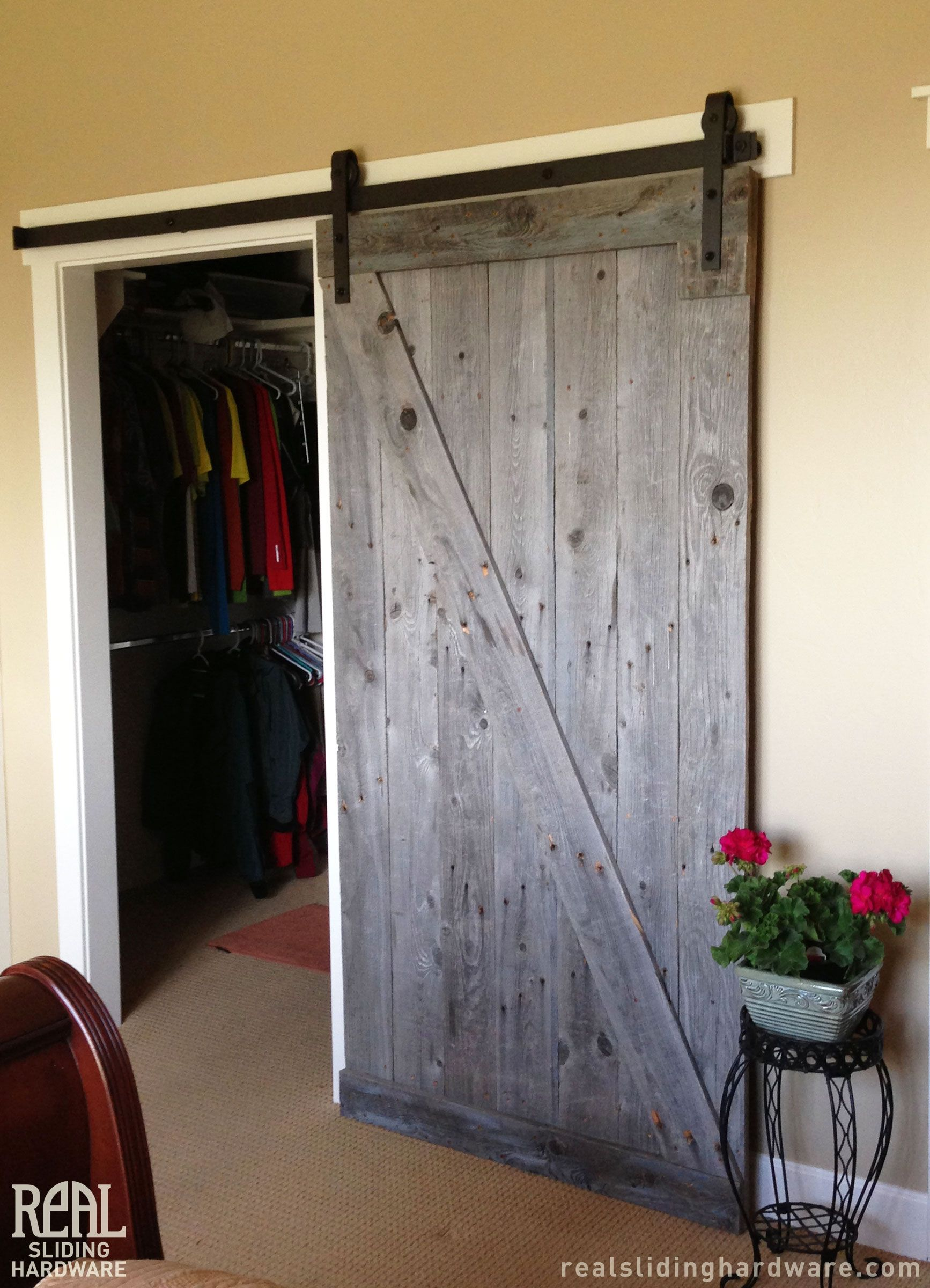 Rugged Z Brace Barn Door Featured With Classic Flat Track Hardware Used As A Closet Door Rustic Wood Doors Barn Door Hardware Barn Door