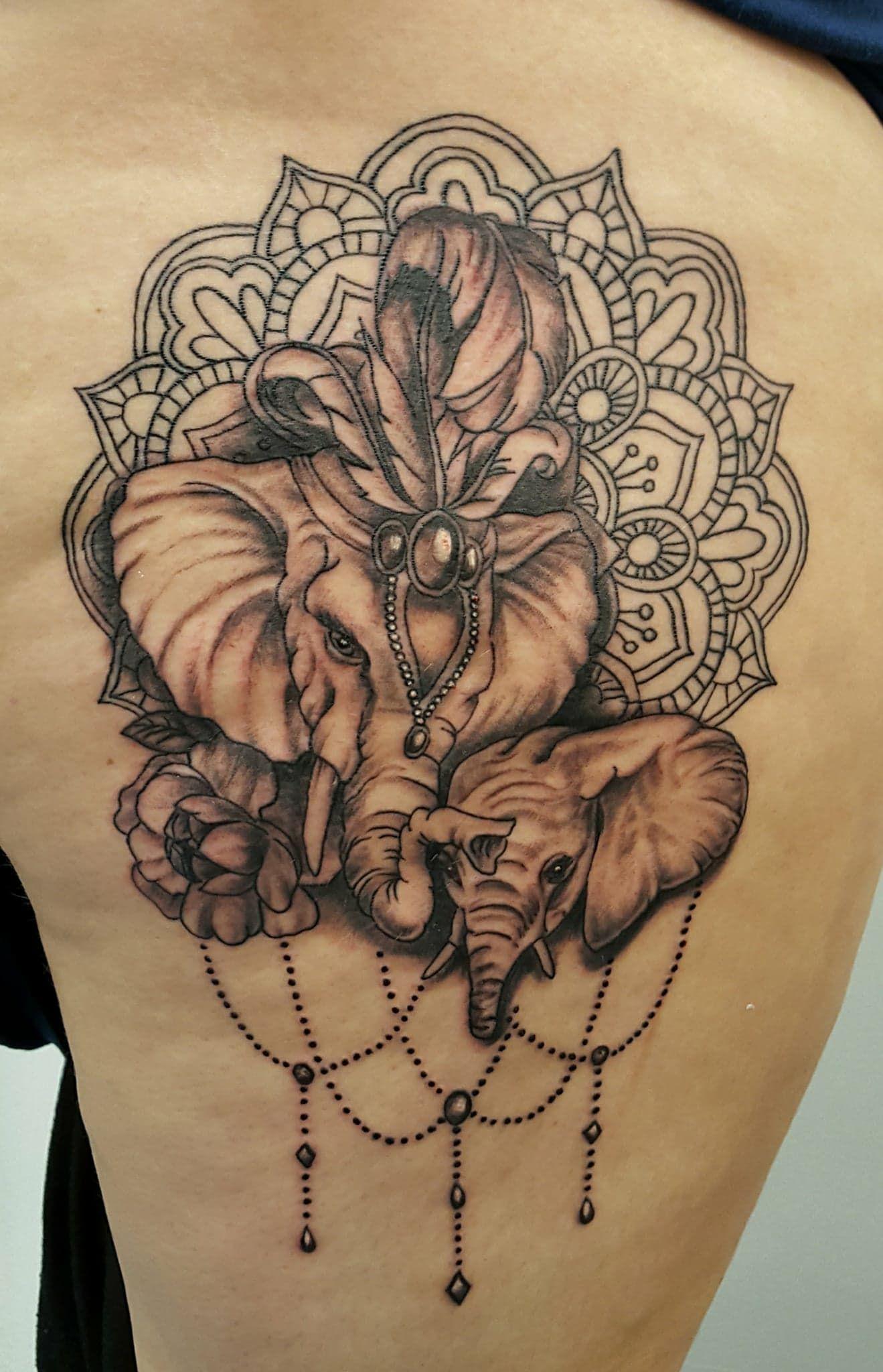 Mummy and baby elephant tattoo with mandala, flowers and