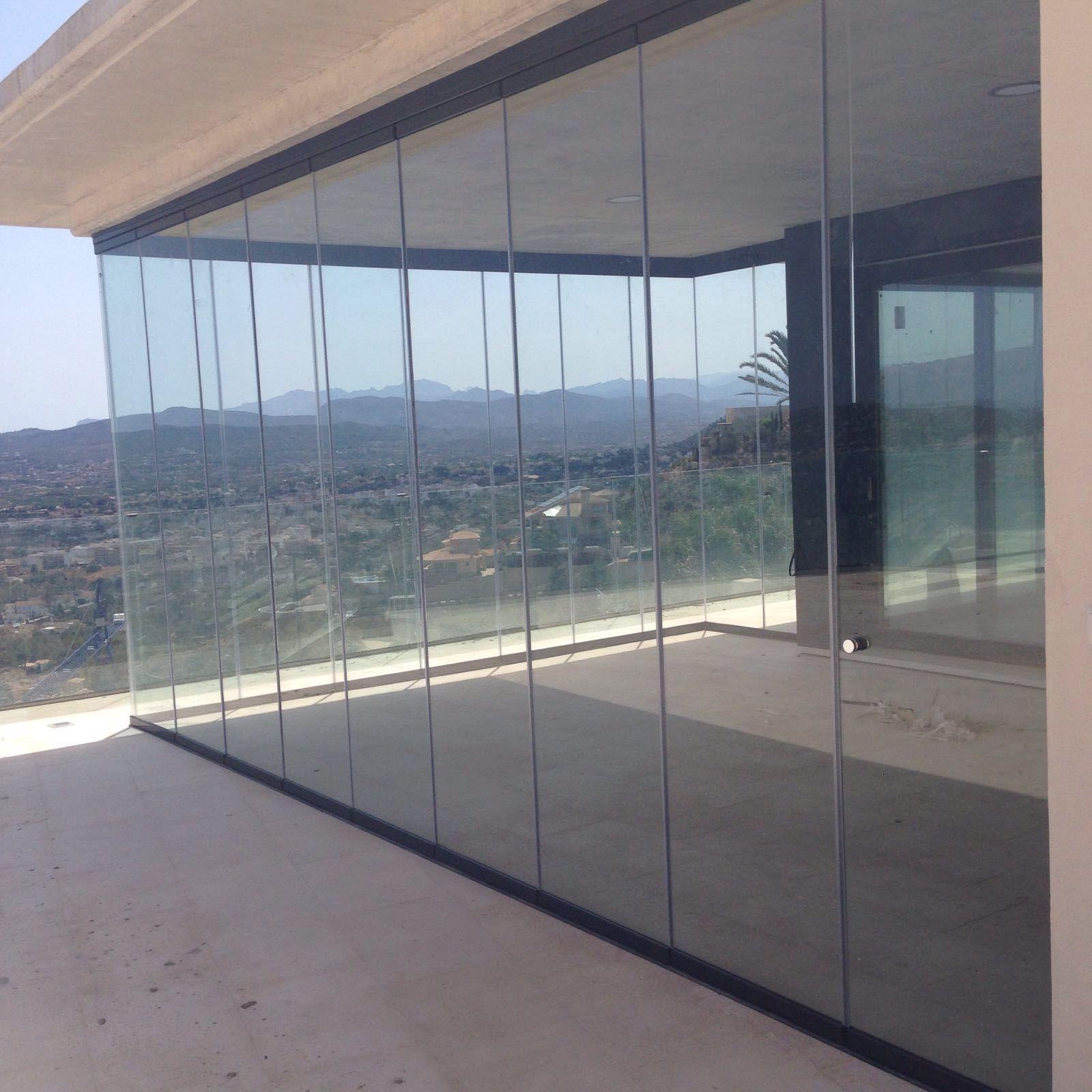Instalaci n de cortina de cristal en javea cerramiento for Cerramiento aluminio terraza
