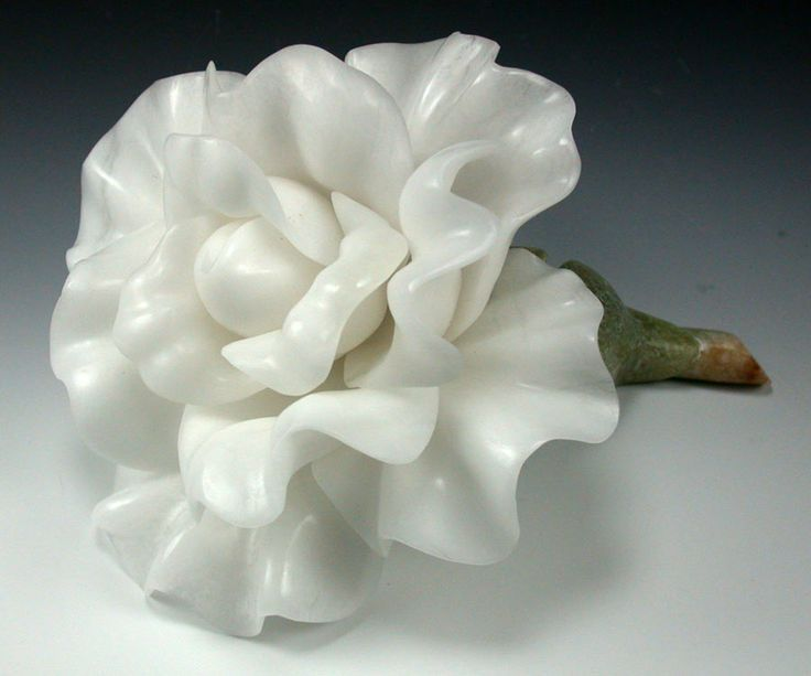 The Alabaster Snow Rose at the curve of Countess Emilia's alabaster cane