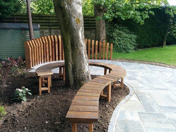 curving bench under a tree designed and built by vialii garden design secret garden. Black Bedroom Furniture Sets. Home Design Ideas