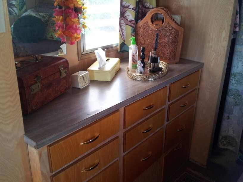 Built-in drawers in bedroom area.