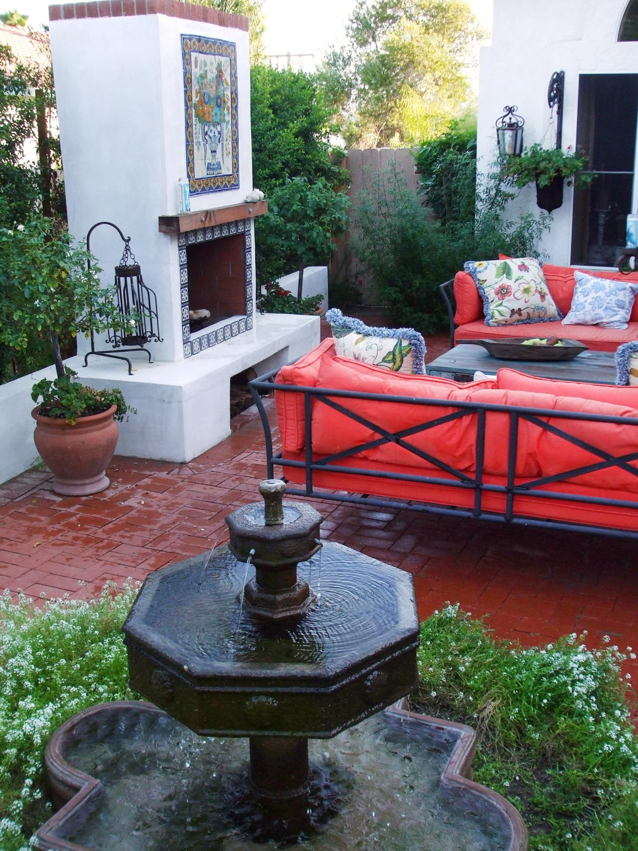 spanish flair is accented in this cozy courtyard a simple two rh pinterest fr