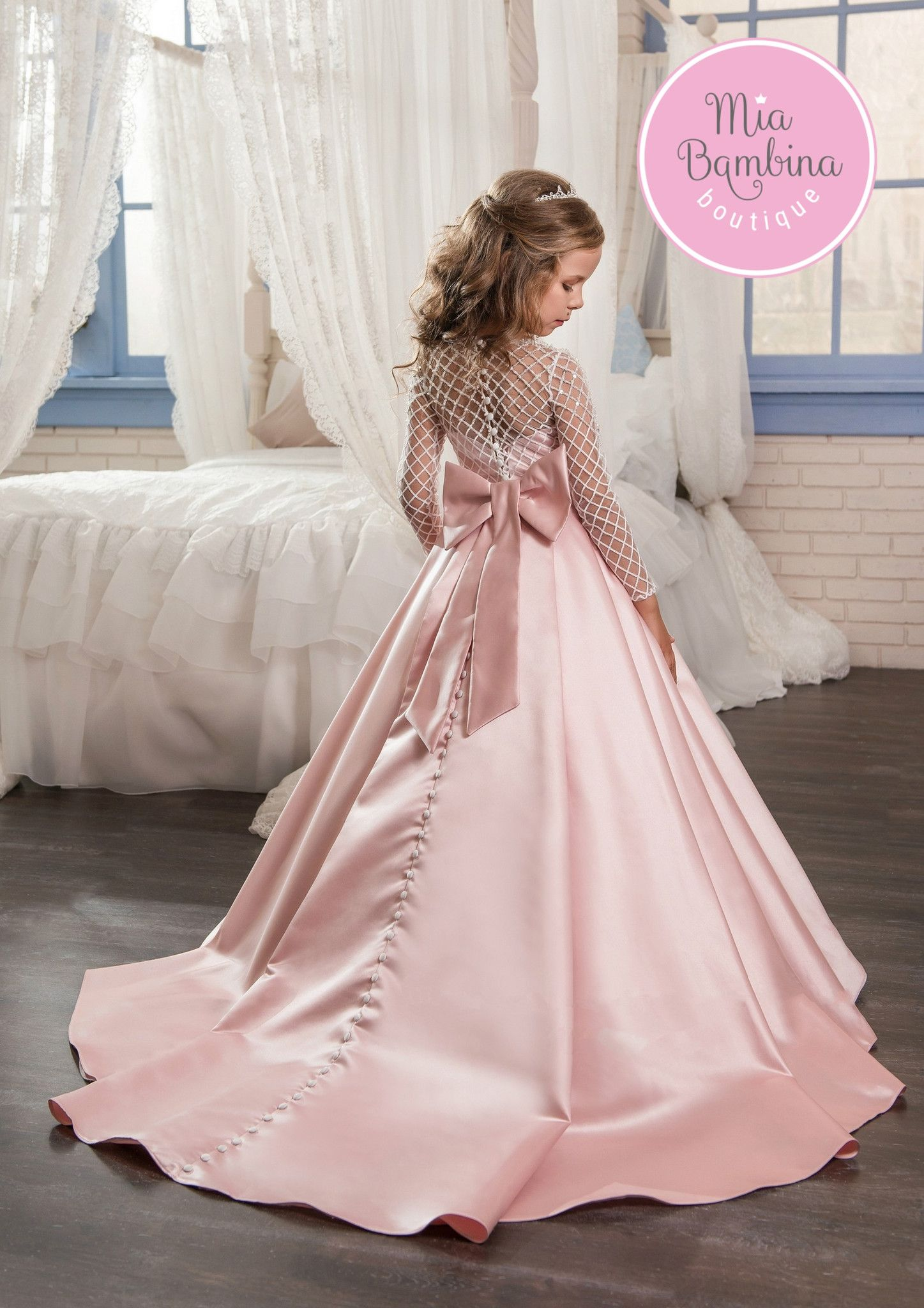 58e6c7227d0 This chic Toronto flower girl dress is a long satin ball gown for  vintage-inspired weddings. It features a long-sleeved top embroidered with  textured ...