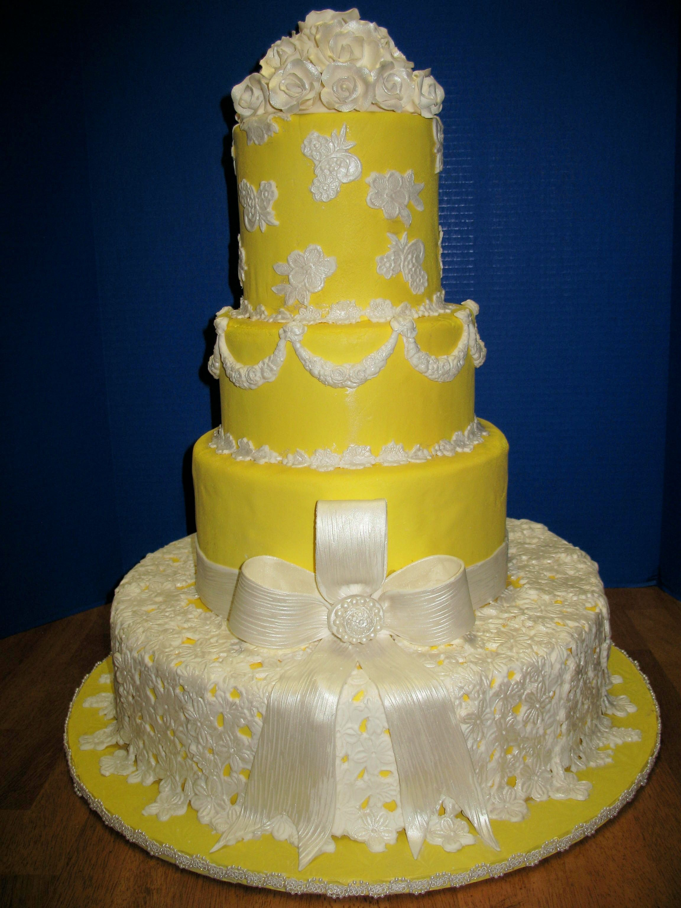 yellow wedding cake with white lace and bow Cheesecake Etc ...