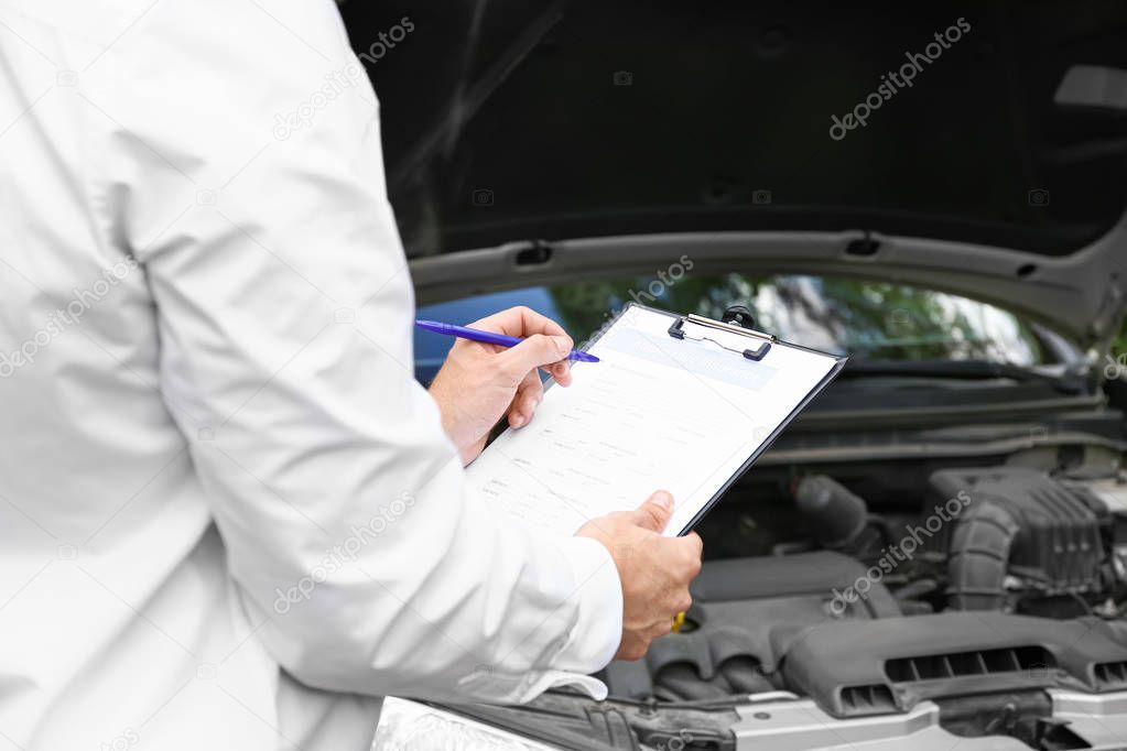 Insurance Agent Near Damaged Car Outdoors Closeup Stock Photo