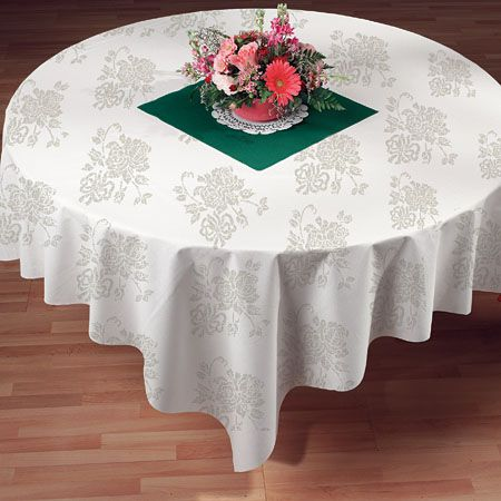 Another paper-feels-like-cloth table cover.  And look at how they used the piece of the table runner in the middle. They have it in silver and gold too. Pretty!