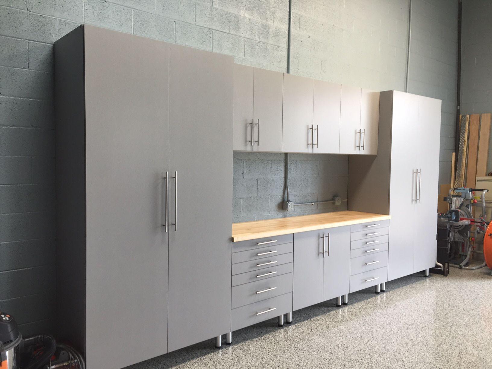 Custom butcher block workbench London Grey Cabinets epoxy floor
