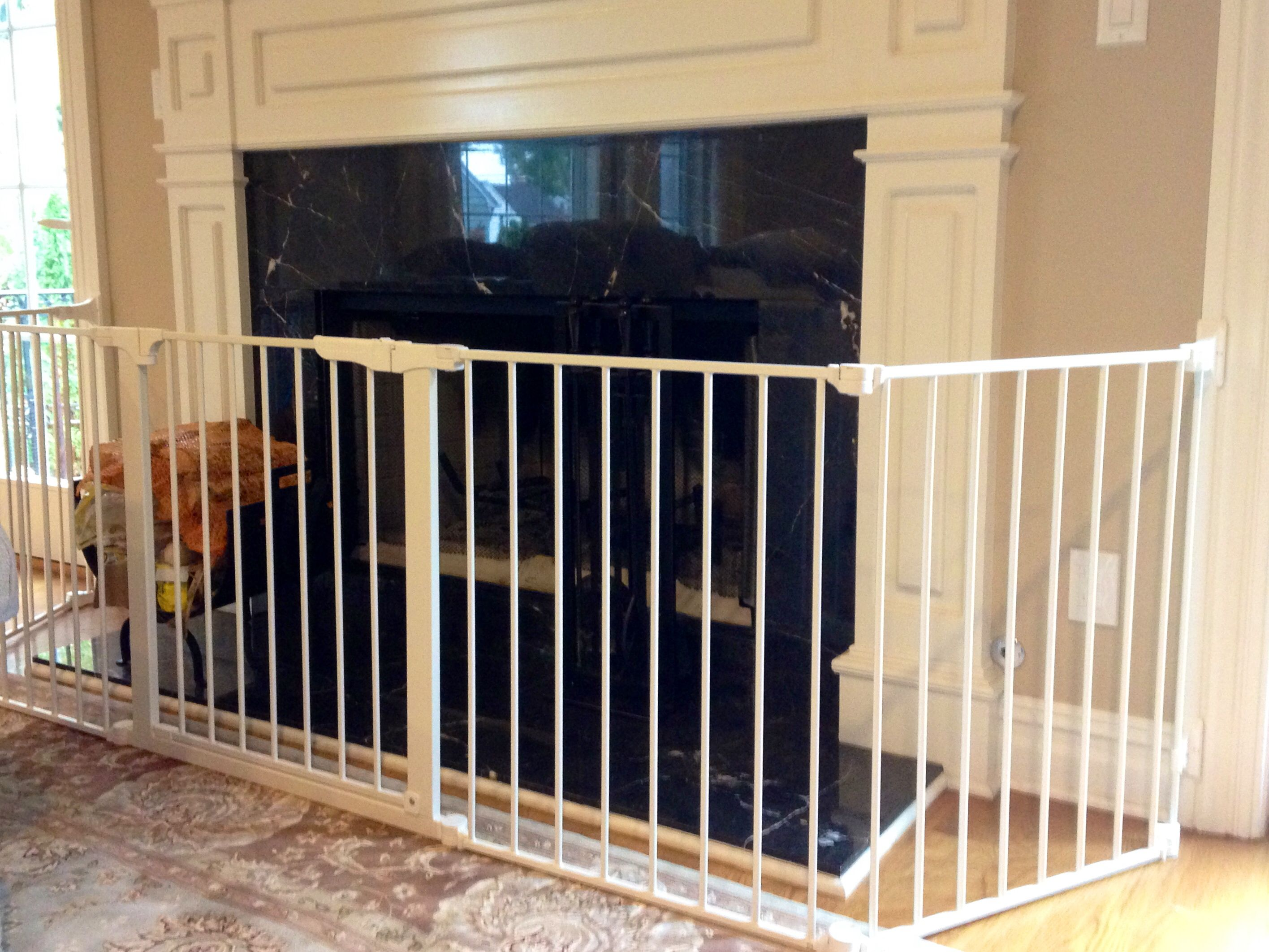 Secure Your Fireplace With A Baby Gate That Keeps Your