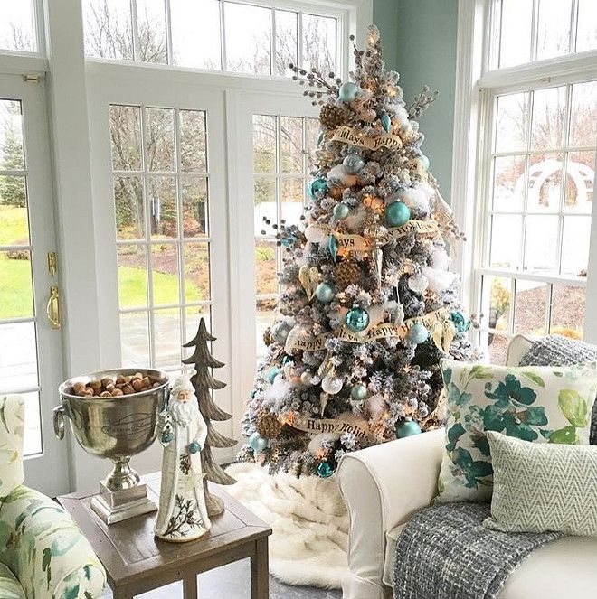 Benjamin Moore Catalina Blue. Wall paint color is Benjamin Moore Catalina Blue. When the Tree Decor Matches the Wall Color #BenjaminMooreCatalinaBlue Susan Lynn via Instagram @stylebysusanlynn.