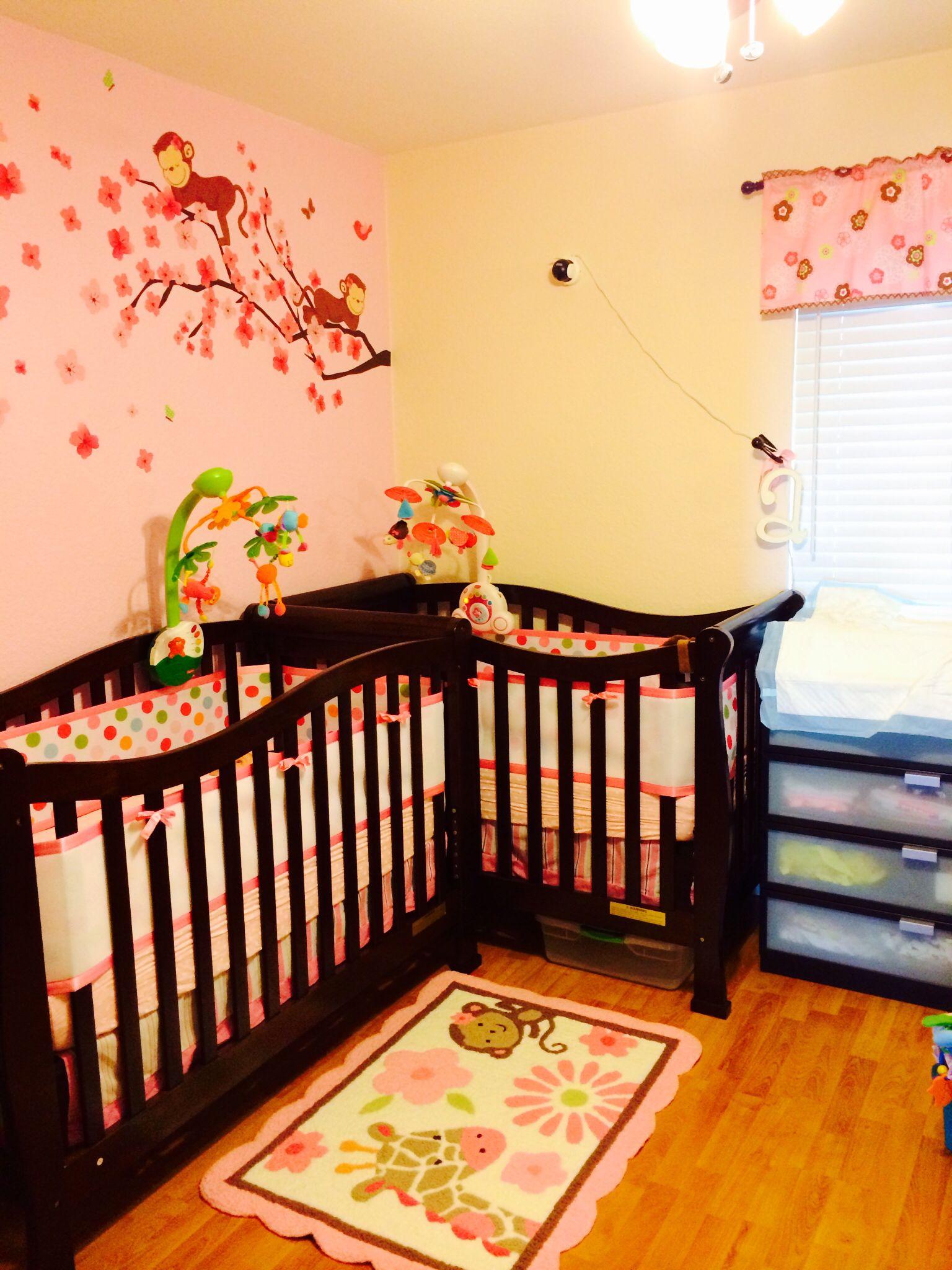 Twin girl nursery in a small room - L shape. Monkey-themed ...