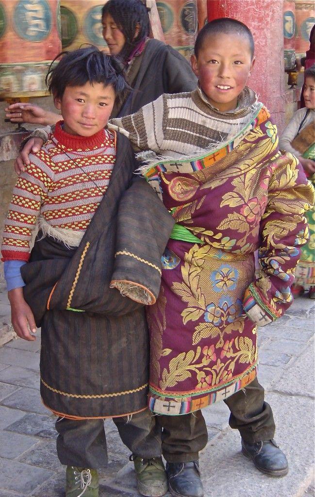 Young Tibetan nomads visiting Kumbum Monastery.
