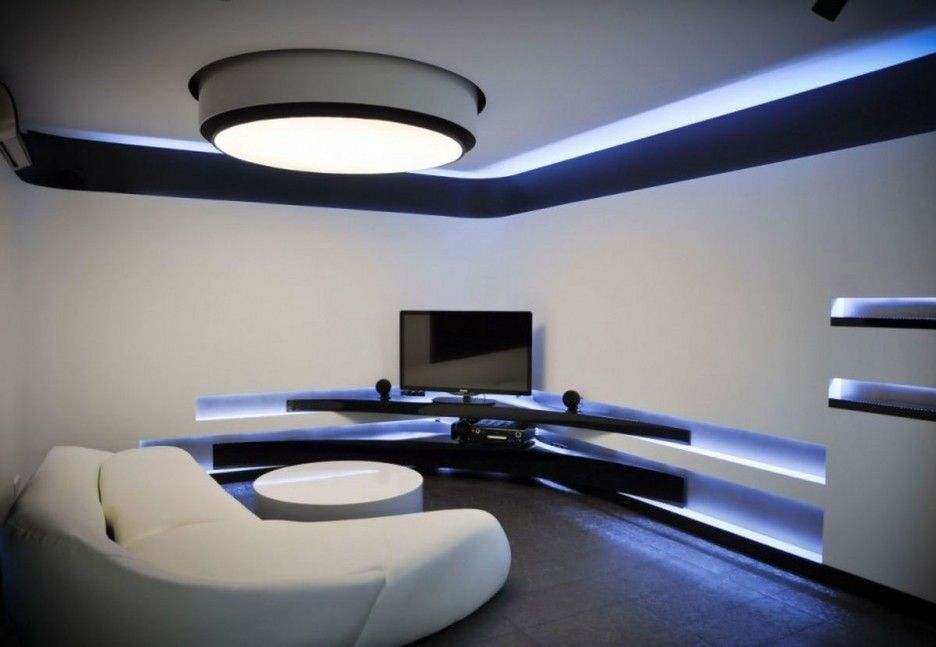 futuristic white and black interior media room design with corner black panels tv stand with open shelf and wall built in shelving with recessed lights