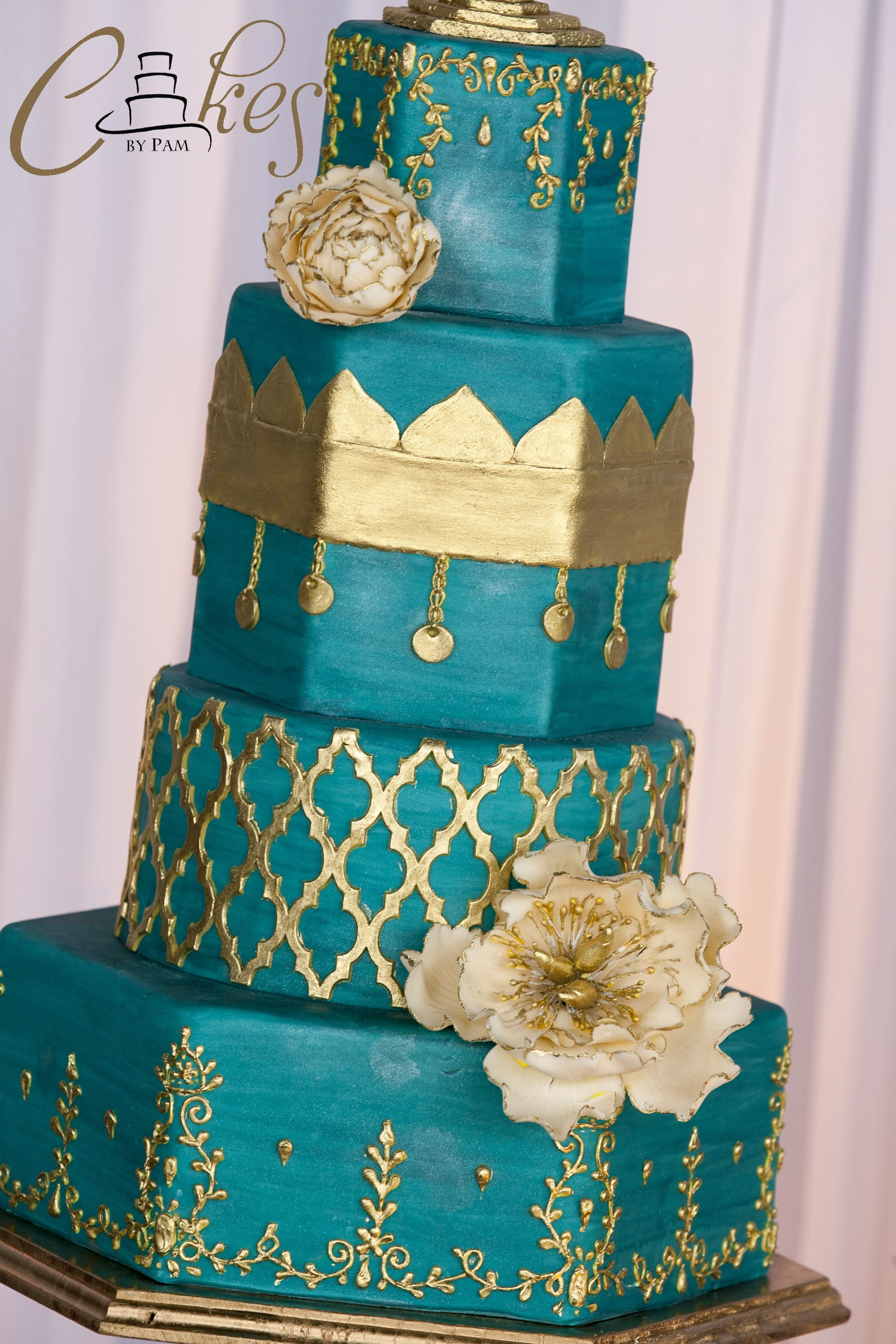Moroccan Inspired Wedding Cake With Intricate Scrollwork Lattice And Sugar Peonies