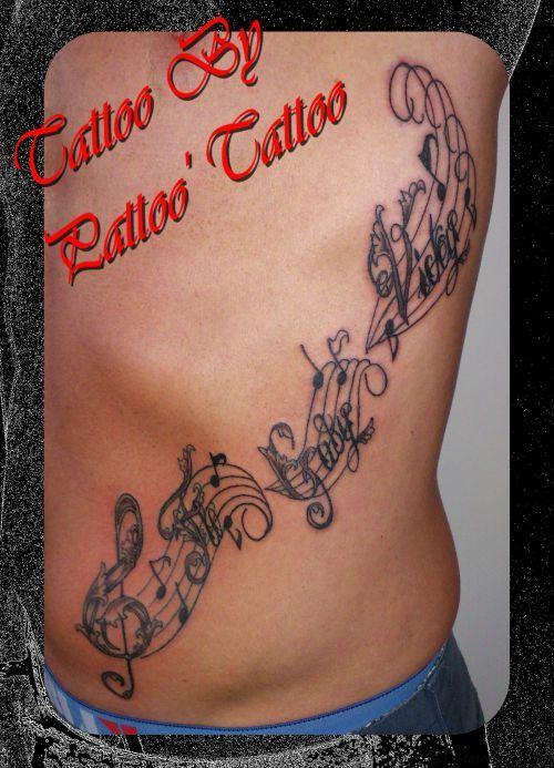 tatouages Lettrage et clé de sol, lettrage, clé de sol  http://www.le-tatouage.com/tattoo-piercing/32/6228/tatouages-lettrage-et-cle-de-sol.html