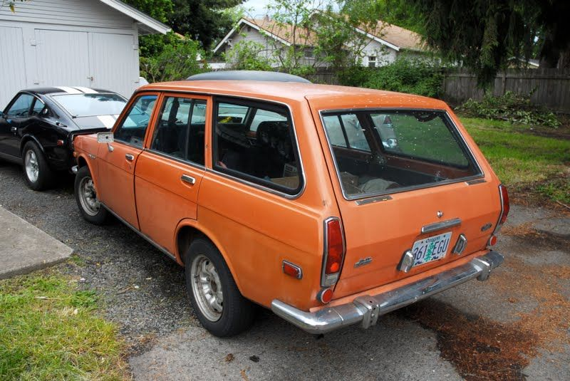 Datsun B201 wagon. Orange. This was our family car!