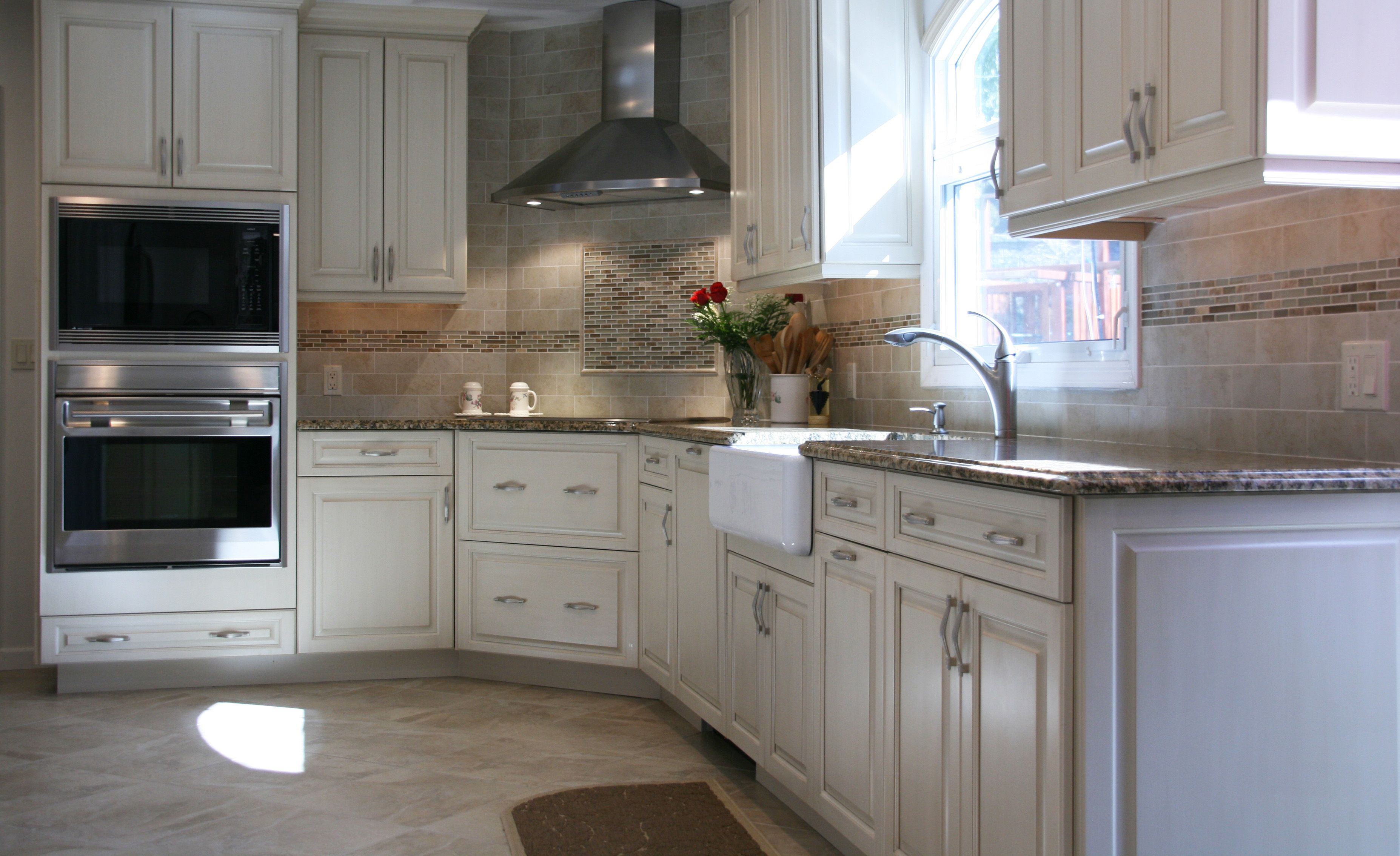 White Raised Panel Kitchen Cabinets With A Linen Brushed ...