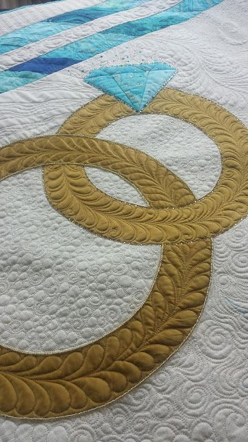 Wedding Quilt.  Designed and quilted by Susan Lawson.  Seaminglyslawsonquilts.blogspot.com
