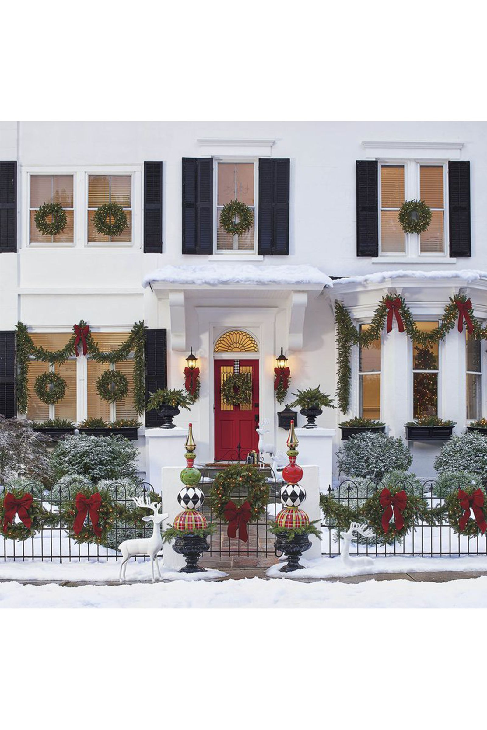Above exterior window decor   ways to make the most out of your garland this christmas