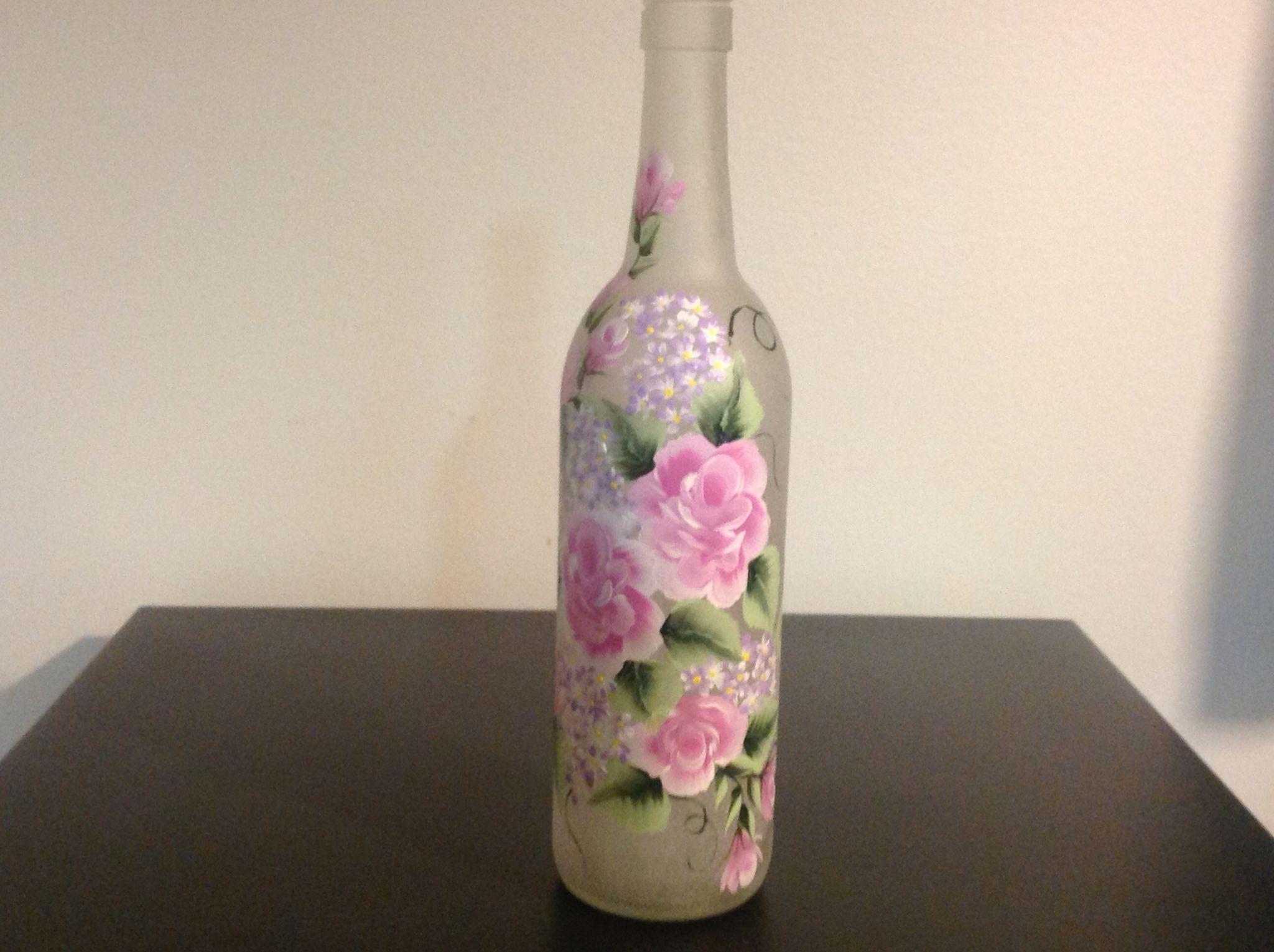 Pink roses lighted wine bottle