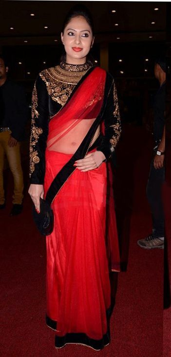 3b098b0acfb4ed Red saree with black and gold long sleeved blouse.