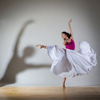 Rule of Thirds: The woman dancing is the main focus of the image. She is intentionally positioned on the one-third line of the image. This gives the picture a more dynamic appearance than if she were posed in the center of the photograph.