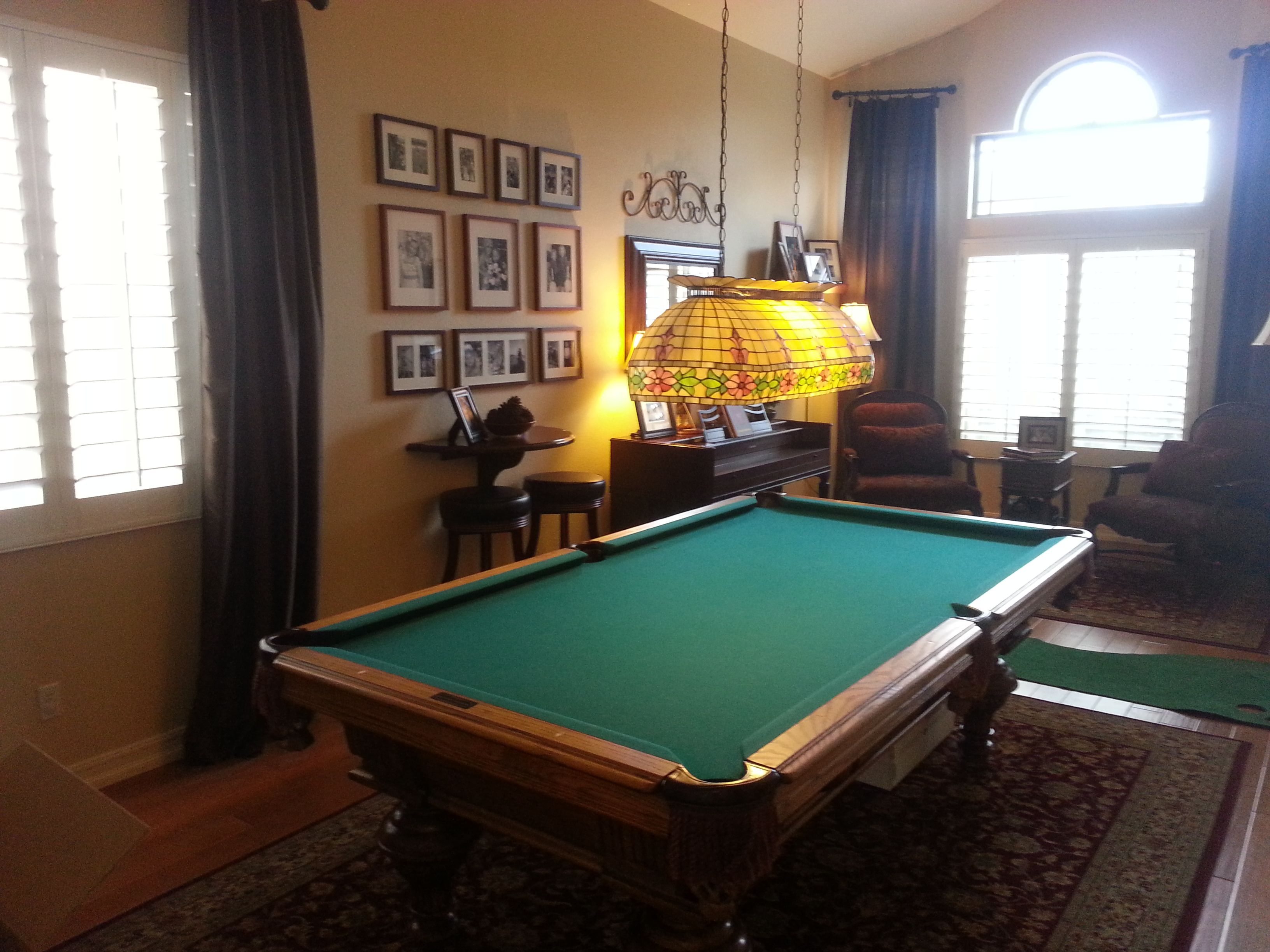 Especially when you're playing said games on a table that transforms from the pool table you're playing on to the dining table you're about to eat on. Pool Table Formal Living Room - Small House Interior Design