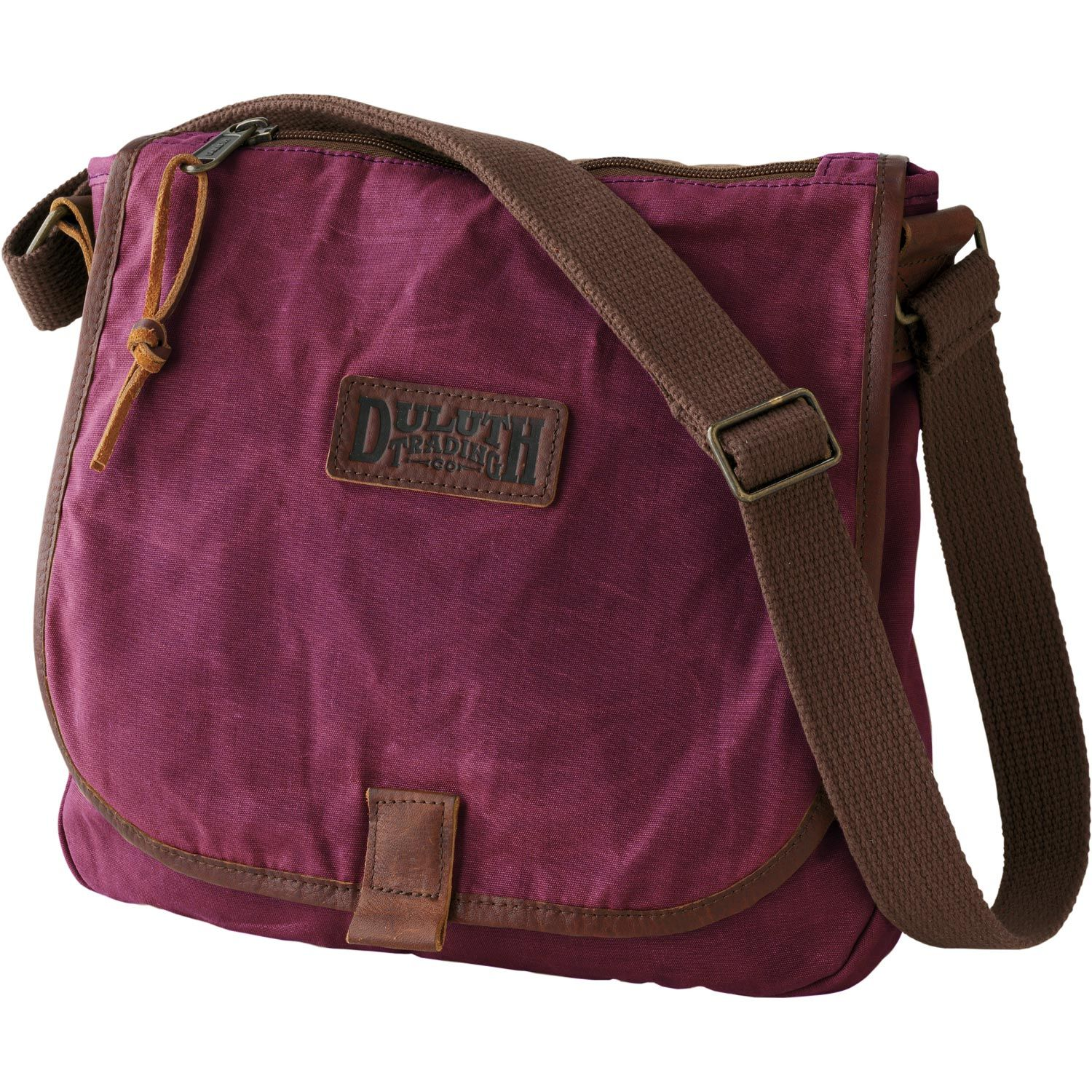 091a9948e3a The women s Oil Cloth Sling Bag from Duluth Trading Company lets you  venture forth without fear of downpours or dumped coffee. Skip the wallet  and stash ...